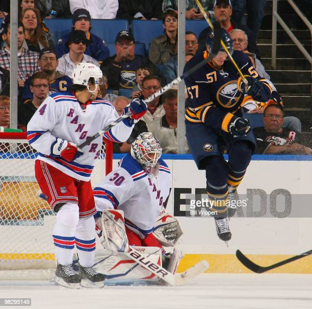 Tyler Myers of the Buffalo Sabres jumps to screen Henrik Lundqvist of the New York Rangers on a goal scored by Jochen Hecht of the Buffalo Sabres on...