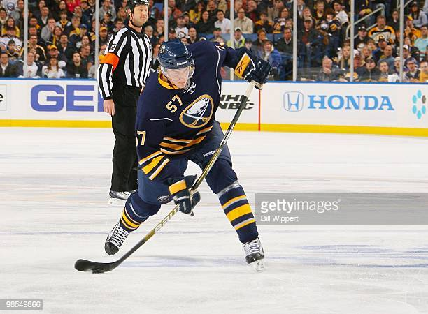 Tyler Myers of the Buffalo Sabres shoots the puck and scores a first period goal against the Boston Bruins in Game Two of the Eastern Conference...