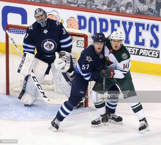 Tyler Myers of the Winnipeg Jets battles Joel Eriksson Ek in Game Five of the Western Conference First Round during the 2018 NHL Stanley Cup Playoffs...