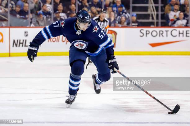 Tyler Myers of the Winnipeg Jets carries the puck down the ice during the overtime period against the Ottawa Senators at the Bell MTS Place on...