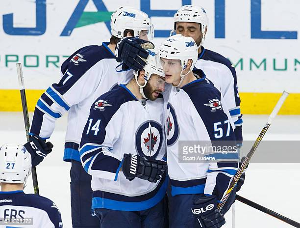 Tyler Myers of the Winnipeg Jets celebrates a goal with teammate Anthony Peluso against the Tampa Bay Lightning during the second period at the...