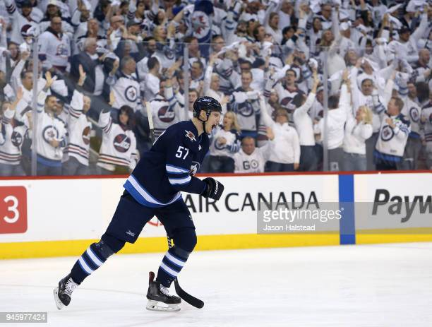 Tyler Myers of the Winnipeg Jets celebrates scoring against the Minnesota Wild in Game Two of the Western Conference First Round during the 2018 NHL...