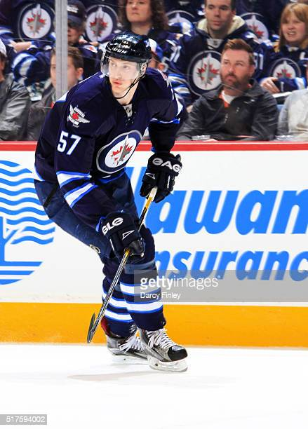 Tyler Myers of the Winnipeg Jets follows the play down the ice during first period action against the Chicago Blackhawks at the MTS Centre on March...