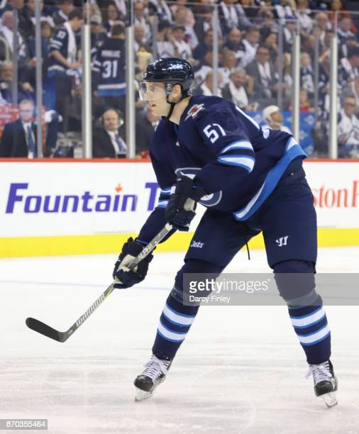 Tyler Myers of the Winnipeg Jets follows the play down the ice during second period action against the Pittsburgh Penguins at the Bell MTS Place on...
