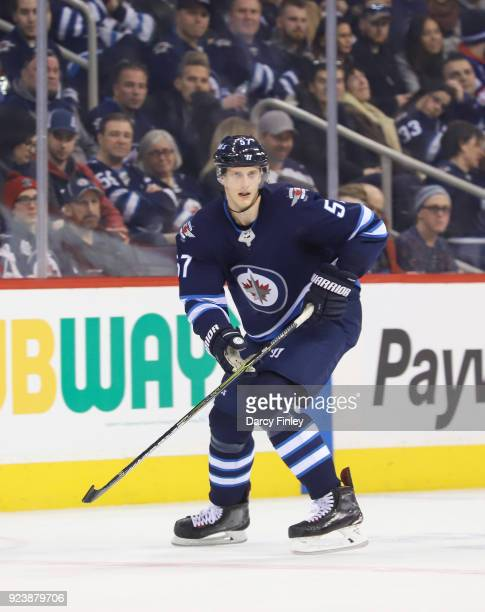 Tyler Myers of the Winnipeg Jets follows the play up the ice during second period action against the Los Angeles Kings at the Bell MTS Place on...
