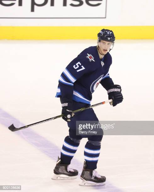Tyler Myers of the Winnipeg Jets keeps an eye on the play during third period action against the Washington Capitals at the Bell MTS Place on...