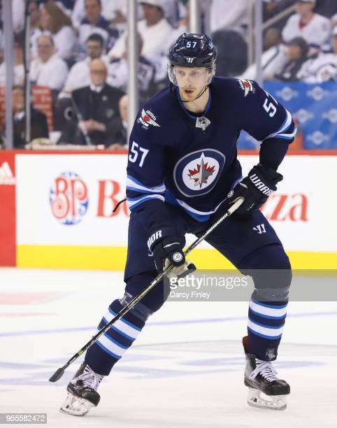 Tyler Myers of the Winnipeg Jets keeps an eye on the play during second period action against the Nashville Predators in Game Four of the Western...