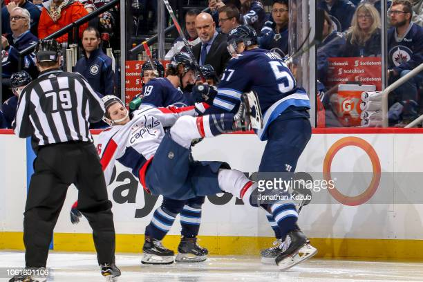 Tyler Myers of the Winnipeg Jets knocks Nic Dowd of the Washington Capitals to the ice after a third period hit at the Bell MTS Place on November 14...