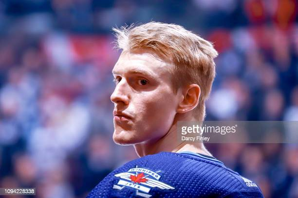 Tyler Myers of the Winnipeg Jets looks on during the singing of the National anthems prior to NHL action against the San Jose Sharks at the Bell MTS...