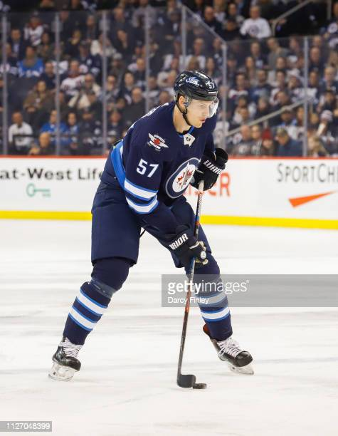 Tyler Myers of the Winnipeg Jets plays the puck down the ice during first period action against the Columbus Blue Jackets at the Bell MTS Place on...
