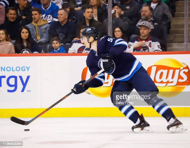 Tyler Myers of the Winnipeg Jets plays the puck up the ice during second period action against the Boston Bruins at the Bell MTS Place on March 14...