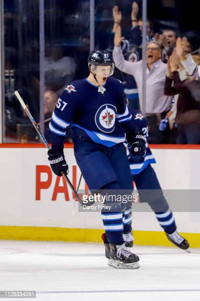 Tyler Myers of the Winnipeg Jets reacts after scoring a third period goal against the Ottawa Senators at the Bell MTS Place on February 16 2019 in...