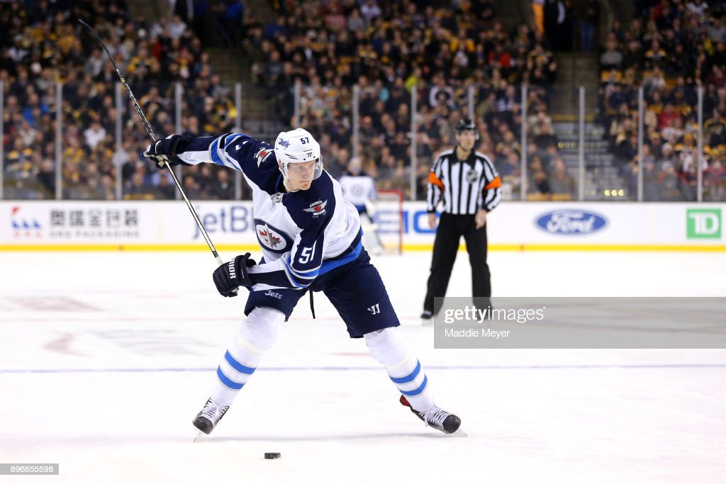 Tyler Myers #57 of the Winnipeg Jets takes a shot against the Boston Bruins during the second period at TD Garden on December 21, 2017 in Boston, Massachusetts.