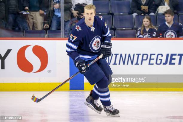 Tyler Myers of the Winnipeg Jets takes part in the pregame warm up sporting a rainbow coloured jersey as well as rainbow coloured stick tape in...