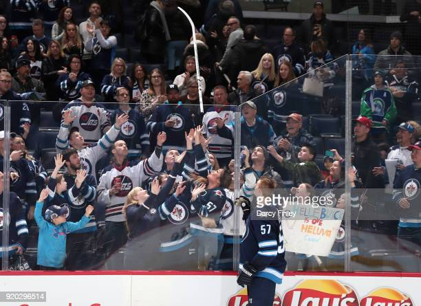 Tyler Myers of the Winnipeg Jets throws his stick over the glass after receiving third star honours following a 72 victory over the Florida Panthers...