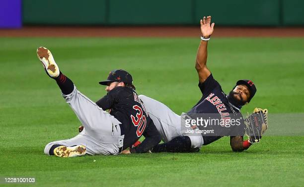 Tyler Naquin and Delino DeShields of the Cleveland Indians collide during the fourth inning against the Pittsburgh Pirates at PNC Park on August 18,...