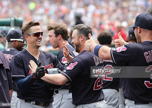 Tyler Naquin and teammates Jason Kipnis and Chris Gimenez of the Cleveland Indians celebrate in the dugout during a four home run inning against the...