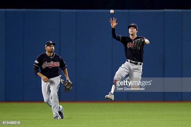 Tyler Naquin of the Cleveland Indians fields a single hit by Ezequiel Carrera of the Toronto Blue Jays to score Troy Tulowitzki in the fourth inning...