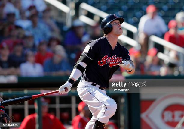 Tyler Naquin of the Cleveland Indians hits a home run in the seventh inning against the Los Angeles Angels of Anaheim during the spring training game...