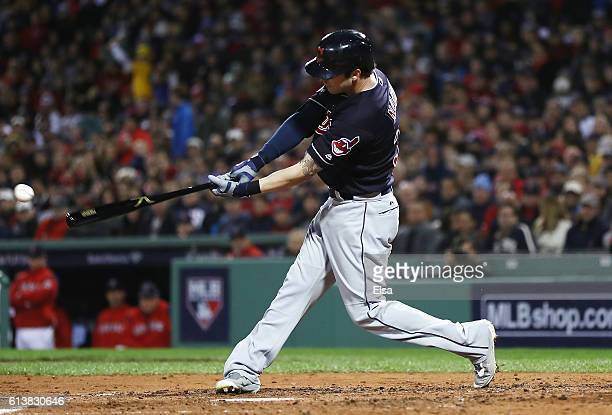 Tyler Naquin of the Cleveland Indians hits a tworun RBI single in the fourth inning against the Boston Red Sox during game three of the American...