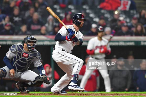 Tyler Naquin of the Cleveland Indians hits a walkoff single during the ninth inning against the Seattle Mariners at Progressive Field on May 03 2019...