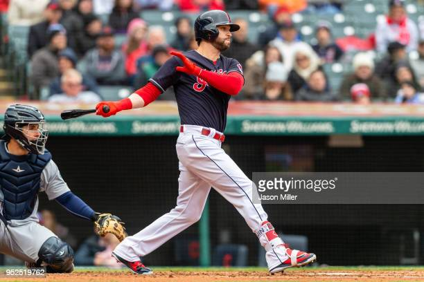 Tyler Naquin of the Cleveland Indians hits an RBI single during the second inning against the Seattle Mariners at Progressive Field on April 28 2018...
