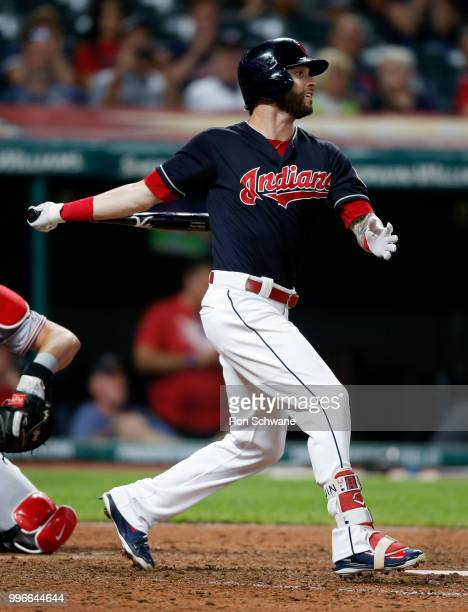 Tyler Naquin of the Cleveland Indians hits an RBI single off Kyle Crockett of the Cincinnati Reds during the seventh inning at Progressive Field on...