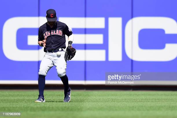 Tyler Naquin of the Cleveland Indians is unable to catch a single hit by Jonathan Villar of the Baltimore Orioles in the ninth inning at Oriole Park...