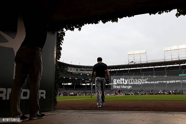 Tyler Naquin of the Cleveland Indians leaves the outfield batting cage prior to Game 4 of the 2016 World Series against the Chicago Cubs at Wrigley...