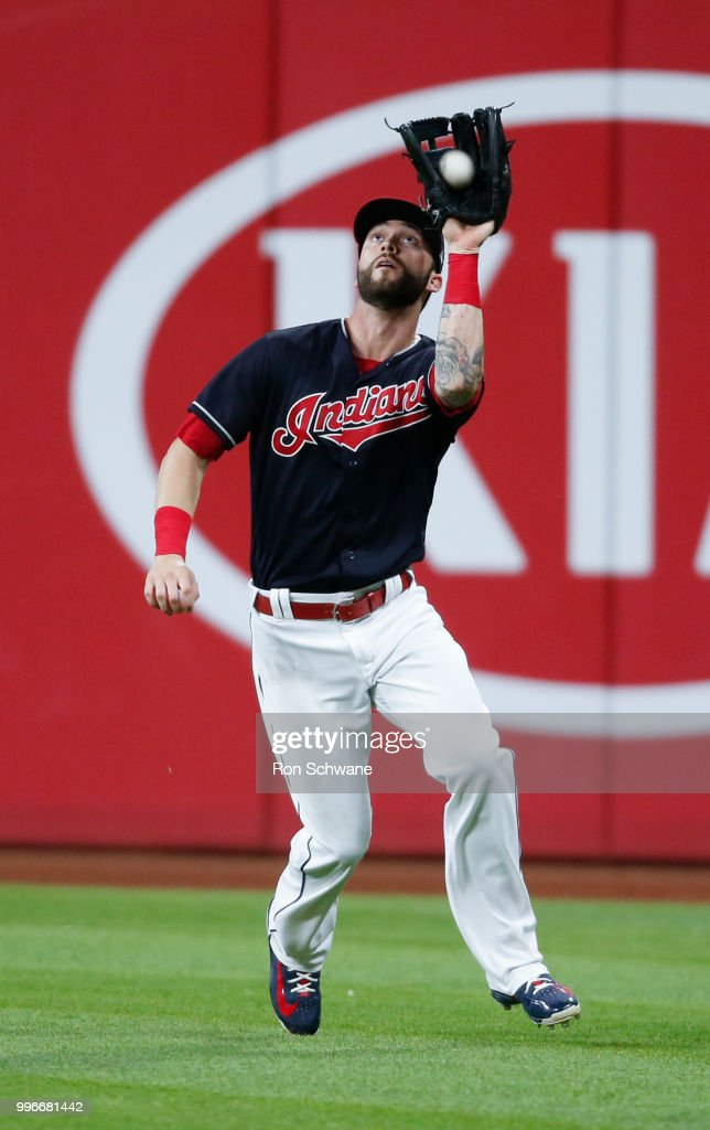 Tyler Naquin #30 of the Cleveland Indians makes a catch to get out Jose Peraza #9 of the Cincinnati Reds during the fifth inning at Progressive Field on July 11, 2018 in Cleveland, Ohio. The Indians defeated the Reds 19-4.