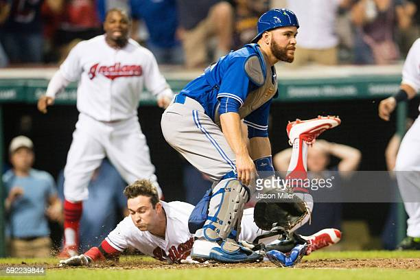 Tyler Naquin of the Cleveland Indians scores a walkoff insidethepark home run as catcher Russell Martin of the Toronto Blue Jays waits for the throw...
