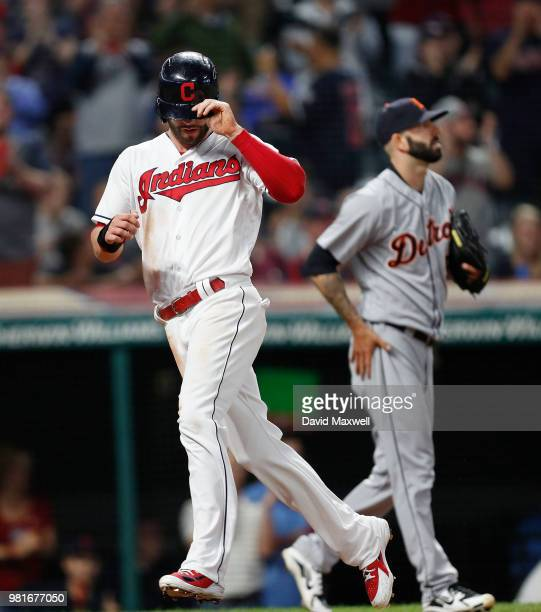 Tyler Naquin of the Cleveland Indians scores on a double by Michael Brantley as pitcher Mike Fiers of the Detroit Tigers backs up the play during the...