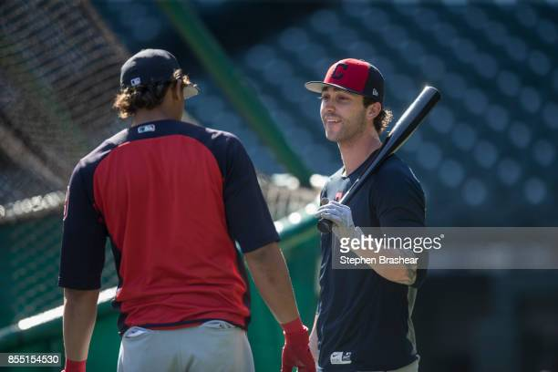 Tyler Naquin right of the Cleveland Indians talks with Erik Gonzalez of the Cleveland Indians during batting practice before a game against the...