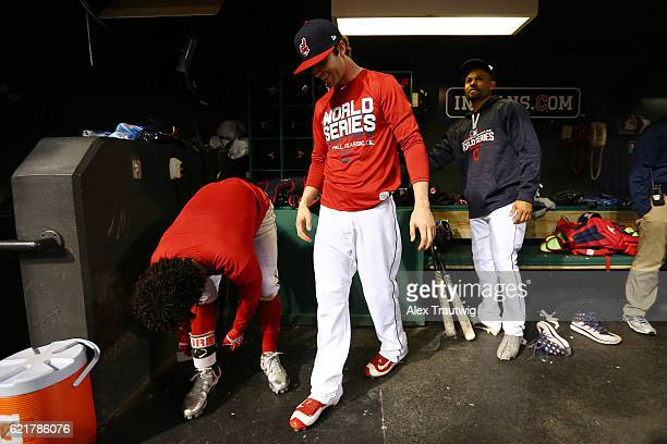 Tyler Naquin speaks with Francisco Lindor of the Cleveland Indians in the dugout during the workout day for the 2016 World Series between the...