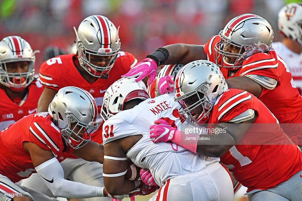 Tyler Natee #31 of the Indiana Hoosiers is ganged up by the Ohio State Buckeyes defense in the fourth quarter for no gain at Ohio Stadium on October 8, 2016 in Columbus, Ohio. Ohio State defeated Indiana 38-17.