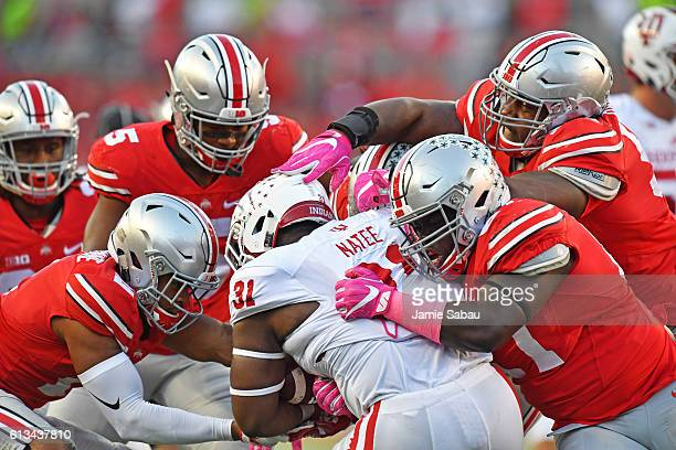 Tyler Natee of the Indiana Hoosiers is ganged up by the Ohio State Buckeyes defense in the fourth quarter for no gain at Ohio Stadium on October 8...