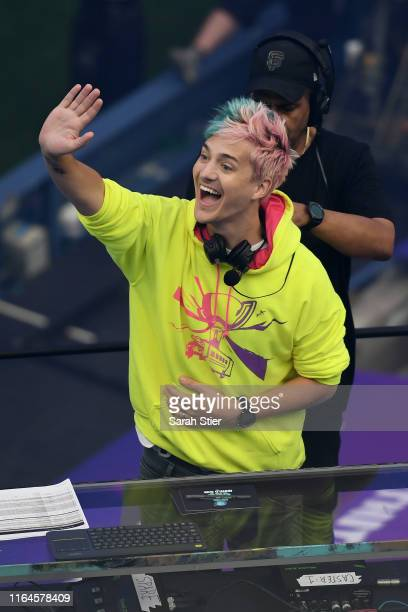 Tyler Ninja Blevins waves to a crowdmember druing day two of the Fortnite World Cup Finals at Arthur Ashe Stadium on July 27 2019 in the Queens...