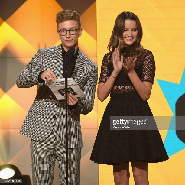 Tyler Oakley and Annie LeBlanc speak onstage during The 8th Annual Streamy Awards at The Beverly Hilton Hotel on October 22 2018 in Beverly Hills...
