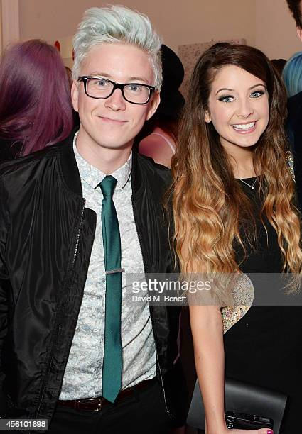 Tyler Oakley and Zoe Sugg attend YouTube phenomenon Zoe Sugg's launch of her debut beauty collection at 41 Portland Place on September 25 2014 in...