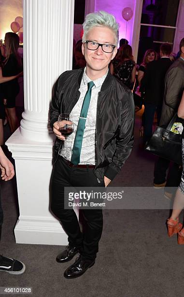 Tyler Oakley attends YouTube phenomenon Zoe Sugg's launch of her debut beauty collection at 41 Portland Place on September 25 2014 in London England