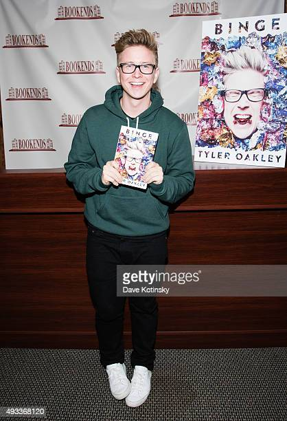 Tyler Oakley signs copies of his new book 'Binge' at Bookends Bookstore on October 19 2015 in Ridgewood New Jersey
