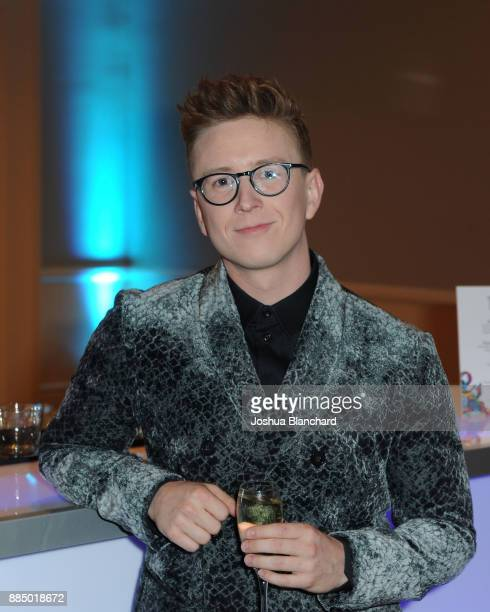 Tyler Oakley toasts with Three Olives Vodka in support of The Trevor Project at TrevorLIVE Gala at The Beverly Hilton Hotel on December 3 2017 in...