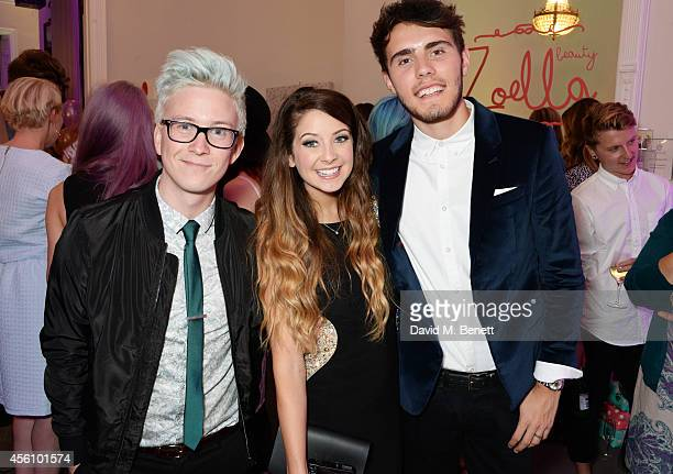 Tyler Oakley Zoe Sugg and Alfie Deyes attend YouTube phenomenon Zoe Sugg's launch of her debut beauty collection at 41 Portland Place on September 25...