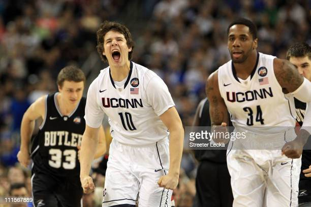 Tyler Olander of the Connecticut Huskies reacts after a play against the Butler Bulldogs during the National Championship Game of the 2011 NCAA...