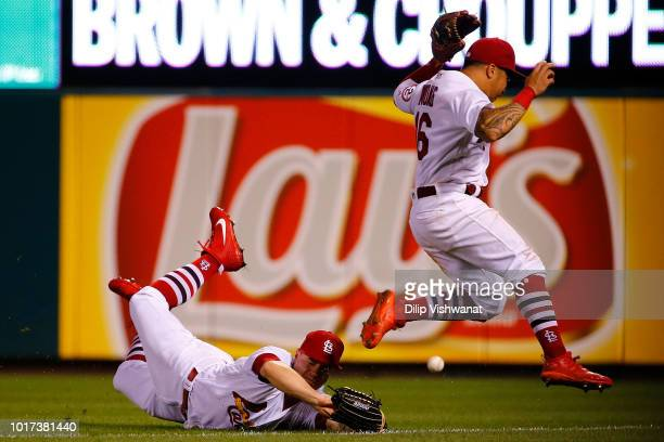 Tyler O'Neill and Kolten Wong of the St Louis Cardinals fail to catch a fall ball against the Washington Nationals in the ninth inning at Busch...