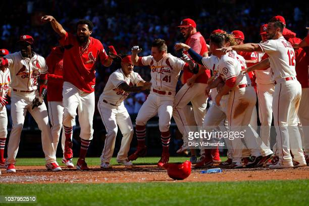 Tyler O'Neill of the St Louis Cardinals celebrates with his teammates after hitting a walkoff home run against the San Francisco Giants in the tenth...