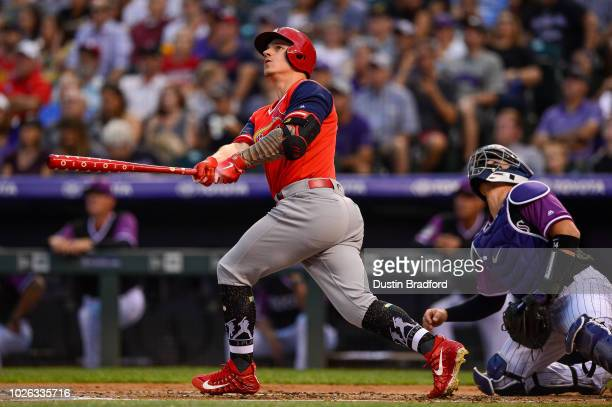 Tyler O'Neill of the St Louis Cardinals follows the flight of a second inning solo homerun against the Colorado Rockies during Players Weekend at...