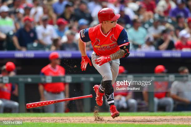 Tyler O'Neill of the St Louis Cardinals hits a sixth inning single against the Colorado Rockies at Coors Field on August 26 2018 in Denver Colorado...