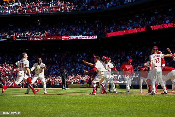 Tyler O'Neill of the St Louis Cardinals is greeted by his teammates after hitting a walkoff home run against the San Francisco Giants in the tenth...