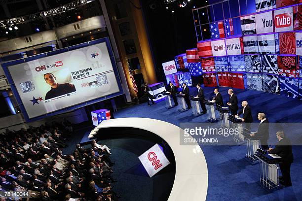 Tyler Overman of Memphis Tennessee is seen on a large screen as he poses a question to Republican presidential hopefuls during the CNN/YouTube...